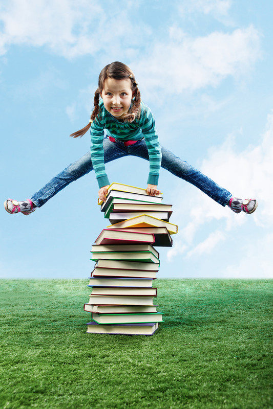 leaping over books-canstockphoto5920546